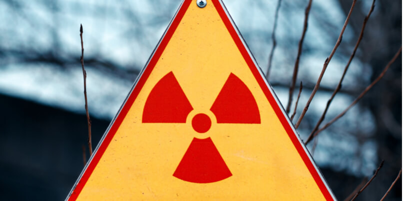 What are the key features and health effects of ionizing radiation?
